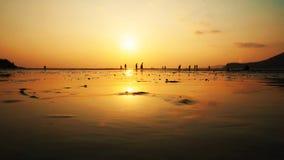 Заход солнца силуэта на море Стоковая Фотография RF