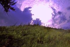 Заход солнца солнца неба облаков холмов гор Стоковые Фото