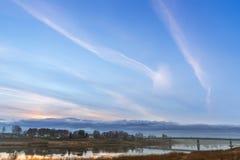 Заход солнца с красивым небом над старыми домами Стоковые Фотографии RF
