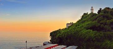 Заход солнца с маяком Стоковые Изображения RF