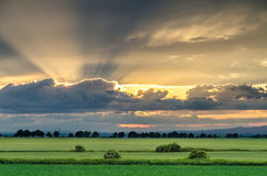 Заход солнца с облачным небом Стоковое Фото