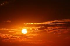 Заход солнца с оранжевым заревом Стоковые Фотографии RF