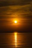 Заход солнца с отражением Стоковое Фото