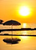 Заход солнца с предпосылкой моря Стоковые Фото
