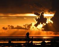 Заход солнца с силуэтами Стоковое фото RF