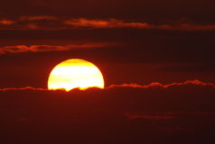 Заход солнца с лучами солнца Стоковое Фото
