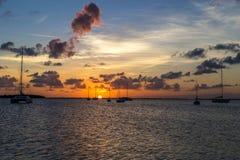 Заход солнца с шлюпками Стоковая Фотография RF