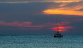 Заход солнца с yatch Стоковые Фото