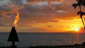 Заход солнца & факел Стоковые Фотографии RF