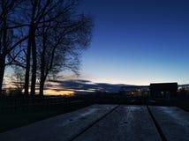Заход солнца через парник Стоковая Фотография RF