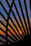Заход солнца через строб Стоковая Фотография
