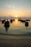 Заход солнца шлюпок в море Стоковое Фото