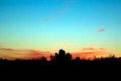 заход солнца яркий Стоковая Фотография