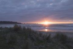 Заход солнца Arago накидки Стоковые Фото