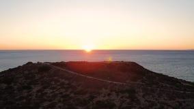 Заход солнца Dume пункта Malibu воздушный сток-видео
