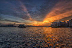 заход солнца Hong Kong Стоковая Фотография