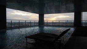 Заход солнца na górze кондоминиума Таиланд Стоковое Фото