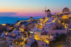 Заход солнца Oia, остров Santorini, Греция Стоковая Фотография