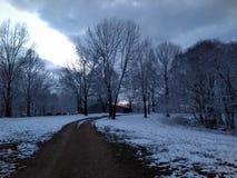 Заход солнца Snowy Стоковые Изображения RF