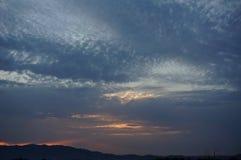 Заход солнца, Troia, Португалия Стоковые Изображения