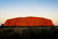 Заход солнца Uluru, захолустье Австралия Стоковая Фотография
