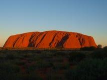 Заход солнца Uluru Стоковая Фотография