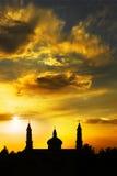 заходящее солнце церков мусульманское s Стоковые Фотографии RF