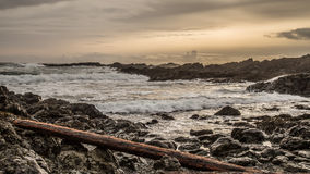 Заходящее солнце на западном побережье Стоковые Изображения