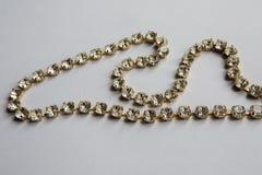 Зашейте оплетку в серебряном цвете с ясный лежать камней стоковое фото rf