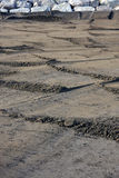 Зашкурьте картину на пляже с утесами в предпосылке Стоковое Изображение RF