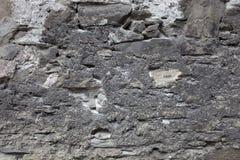 Заштукатуренные старые stonewall, темный серый цвет. Стоковые Изображения