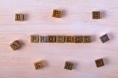 Защитите блок металла слова стоковая фотография rf