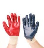 2 защитных перчатки на руках Стоковое Изображение