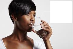 04 задействуя примечание к стеклу с водой Стоковая Фотография RF