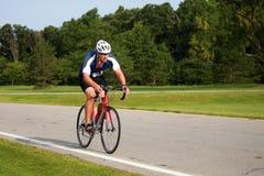задействуя triathlete Стоковые Изображения