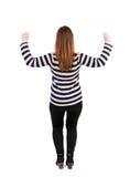заднее клиппирование предпосылки тонет изображение руки включает путь извлекает женщину взгляда Поднял его кулак вверх в знаке по Стоковая Фотография RF