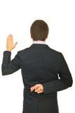 задние детеныши врушки бизнесмена Стоковая Фотография RF