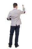 Задний взгляд бизнесмена сочинительства в костюме Стоковое Изображение RF