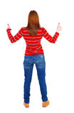 Задний взгляд больших пальцев руки женщины вверх Стоковое Фото