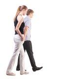 Задний взгляд гуляя молодых пар Стоковые Изображения RF