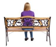 Задний взгляд женщины сидя на стенде Стоковые Фотографии RF