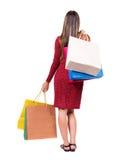 Задний взгляд женщины с хозяйственными сумками Стоковое Изображение