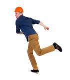 Задний взгляд идущего инженера в шлеме Стоковое Изображение RF