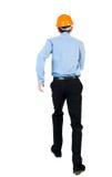 Задний взгляд идущего инженера в шлеме Стоковое Изображение