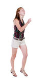 Задний взгляд идущей женщины в шортах Стоковое фото RF