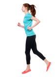 Задний взгляд идущей женщины спорта Стоковое Изображение
