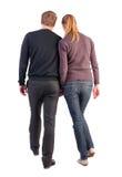 Задний взгляд идя молодых пар Стоковое Фото