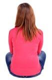 Задний взгляд красивой молодой женщины сидя на floo стоковые фото