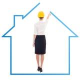 Задний взгляд молодого isolat дома чертежа архитектора бизнес-леди Стоковое Изображение RF