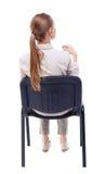 Задний взгляд молодой красивой женщины сидя на стуле Стоковые Изображения RF